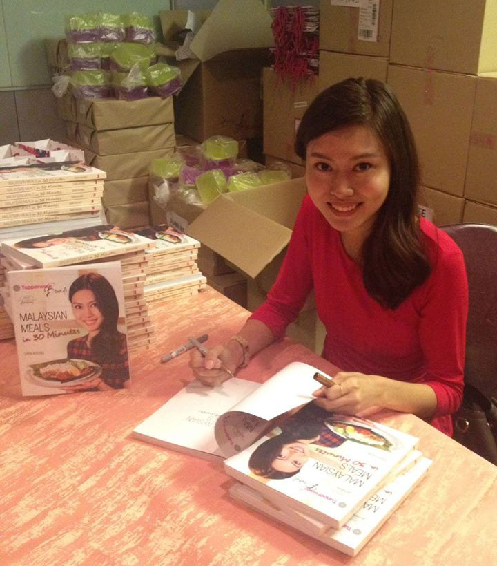 Sara signing books